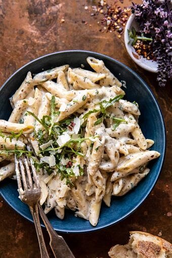 One Pot Creamy Penne Alfredo with Spicy Arugula | halfbakedharvest.com