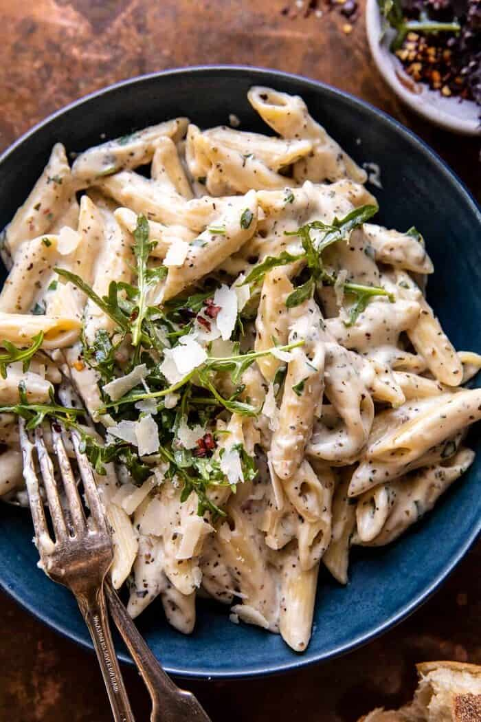overhead close up photo of One Pot Creamy Penne Alfredo with Spicy Arugula