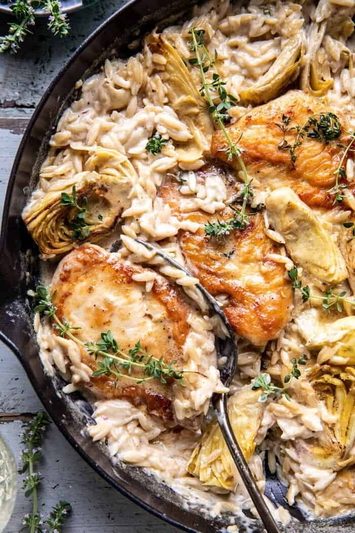 overhead close up photo of One Skillet Creamy Artichoke Chicken Marsala and Orzo