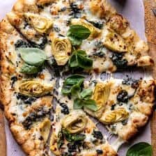 Spinach and Artichoke Pizza with Cheesy Bread Crust.
