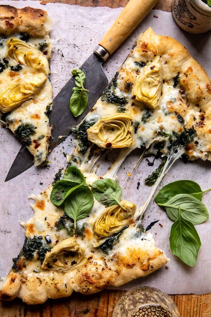 Spinach and Artichoke Pizza with Cheesy Bread Crust | halfbakedharvest.com