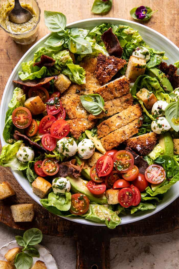 Crispy Italian Chicken and Bacon Salad with Tahini Pesto Dressing and Sourdough Croutons.