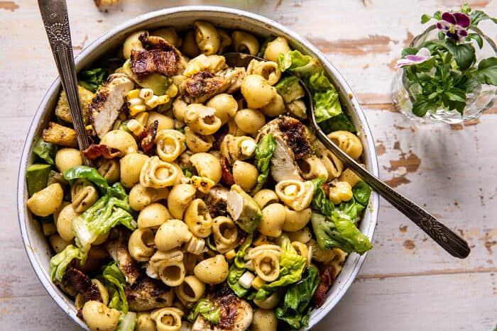 Pesto Chicken, Corn, and Avocado Bacon Pasta Salad | halfbakedharvest.com