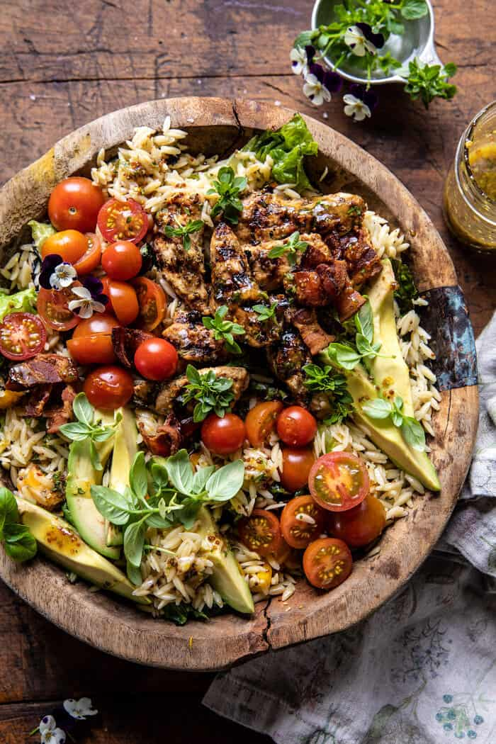 Grilled Lemon Herb Chicken Avocado Orzo Salad with Honey Mustard Bacon Dressing.
